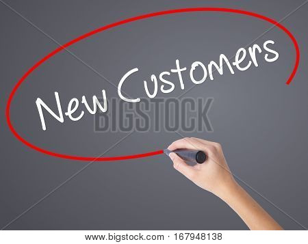 Woman Hand Writing  New Customers With Black Marker On Visual Screen