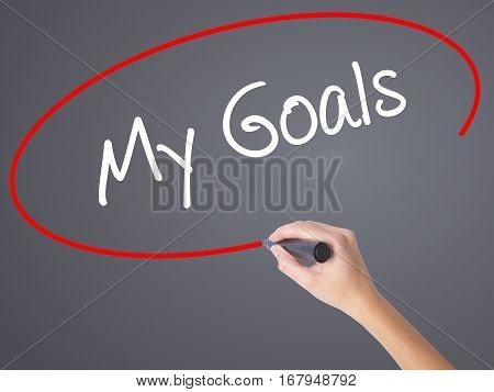 Woman Hand Writing  My Goals With Black Marker On Visual Screen
