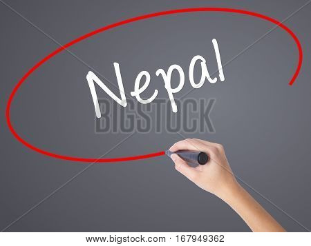 Woman Hand Writing Nepal  With Black Marker On Visual Screen