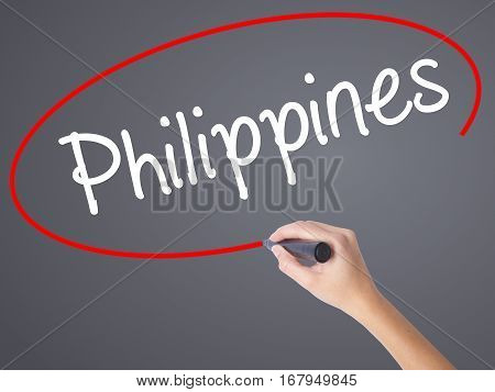 Woman Hand Writing Philippines With Black Marker On Visual Screen