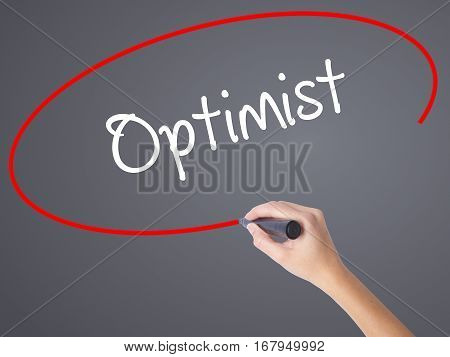 Woman Hand Writing Optimist  With Black Marker On Visual Screen