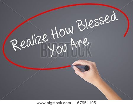 Woman Hand Writing  Realize How Blessed You Are  With Black Marker On Visual Screen