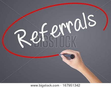 Woman Hand Writing Referrals With Black Marker On Visual Screen.