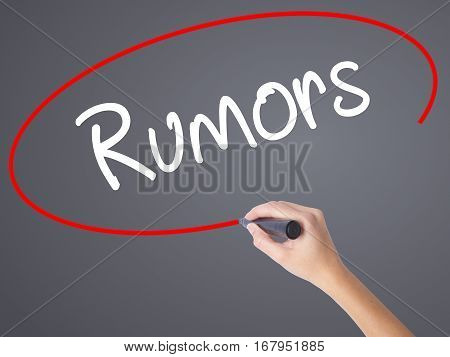 Woman Hand Writing Rumors  With Black Marker On Visual Screen.