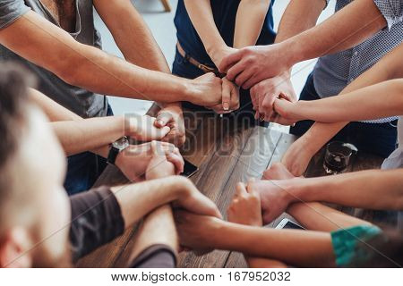 Group of Diverse Hands Together Joining. Concept of teamwork and friendship.
