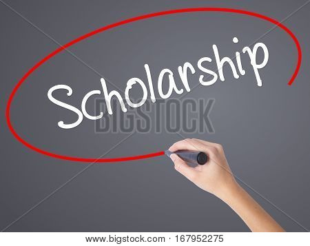 Woman Hand Writing Scholarship With Black Marker On Visual Screen