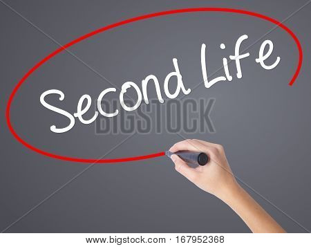 Woman Hand Writing Second Life With Black Marker On Visual Screen.