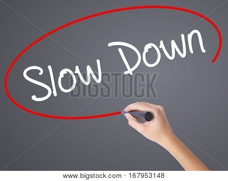 Woman Hand Writing Slow Down With Black Marker On Visual Screen