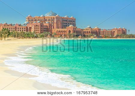 The beautiful private white beach belonging to Emirates Palace Hotel, a luxurious 7 star hotel with its own marina and helipad. Summer holidays concept. Luxury and comfort lifestyle.