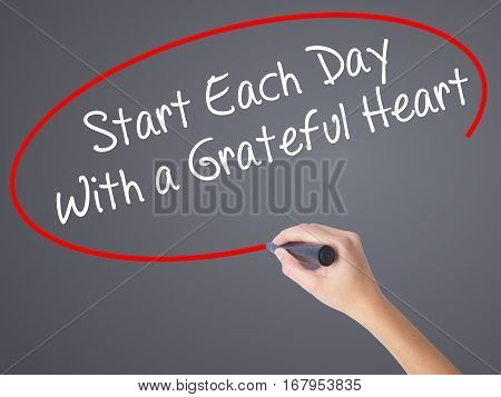 Woman Hand Writing Start Each Day With A Grateful Heart With Black Marker On Visual Screen