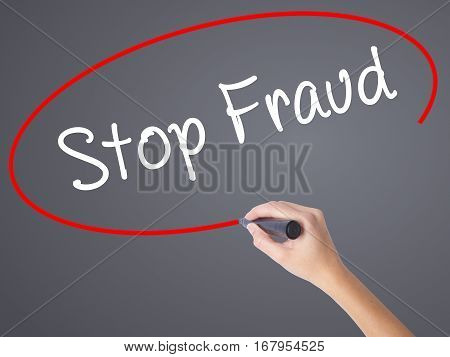 Woman Hand Writing  Stop Fraud  With Black Marker On Visual Screen