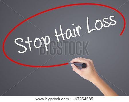 Woman Hand Writing Stop Hair Loss  With Black Marker On Visual Screen