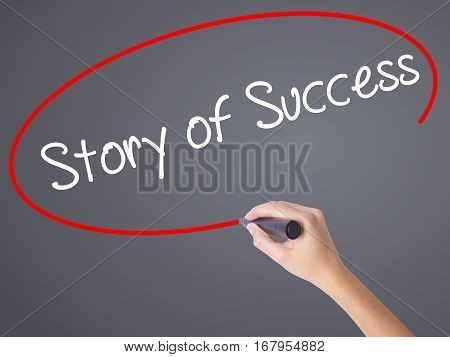 Woman Hand Writing Story Of Success With Black Marker On Visual Screen