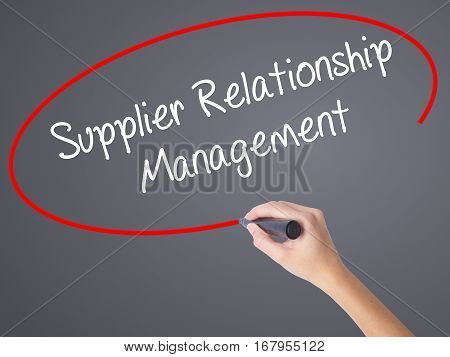 Woman Hand Writing Supplier Relationship Management With Black Marker On Visual Screen.