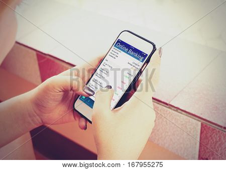 Young Woman Using Mobile Banking With Smartphone.