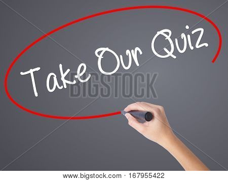 Woman Hand Writing Take Our Quiz With Black Marker On Visual Screen