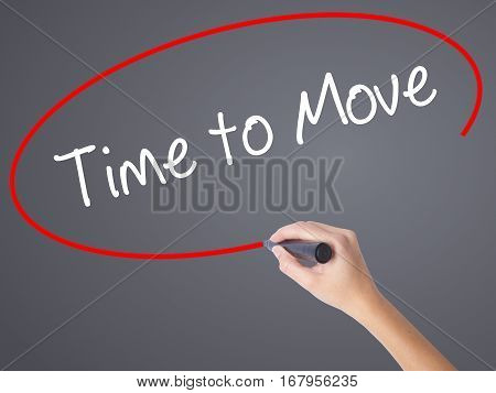 Woman Hand Writing Time To Move With Black Marker On Visual Screen