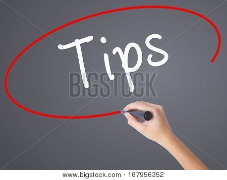 Woman Hand Writing Tips With Black Marker On Visual Screen