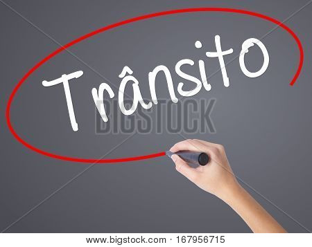 Woman Hand Writing Transito (traffic In Portuguese) With Black Marker On Visual Screen