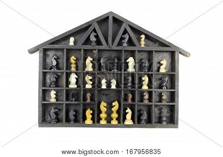vintage black wooden box shelf with variuos chess horse piece isolated on white