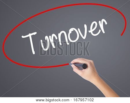 Woman Hand Writing Turnover With Black Marker On Visual Screen