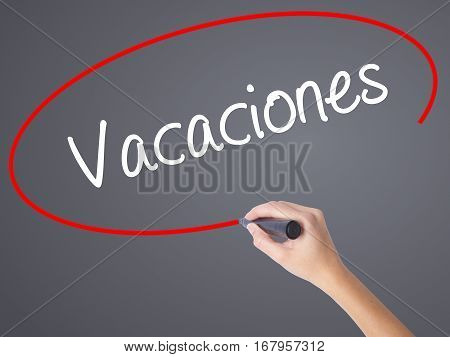 Woman Hand Writing Vacaciones (vacation In Spanish) With Black Marker On Visual Screen