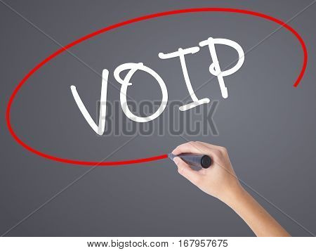 Woman Hand Writing Voip With Black Marker On Visual Screen