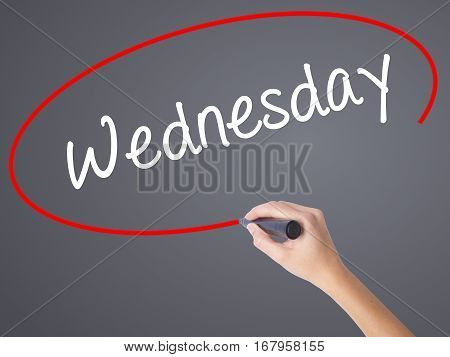 Woman Hand Writing Wednesday  With Black Marker On Visual Screen