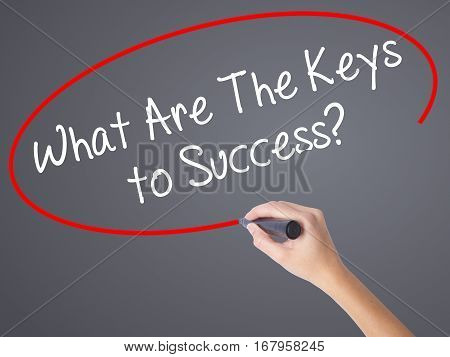 Woman Hand Writing What Are The Keys To Success? With Black Marker On Visual Screen