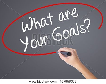 Woman Hand Writing What Are Your Goals?  With Black Marker On Visual Screen