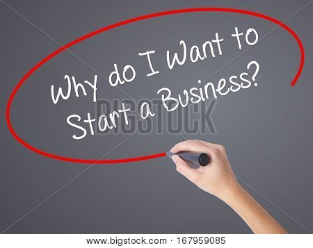 Woman Hand Writing Why Do I Want To Start A Business? With Black Marker On Visual Screen
