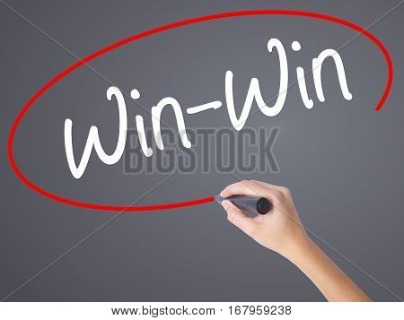 Woman Hand Writing Win-win With Black Marker On Visual Screen.