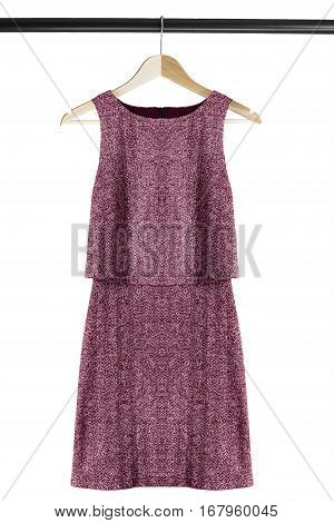 Elegant tweed dress on clothes rack isolated over white
