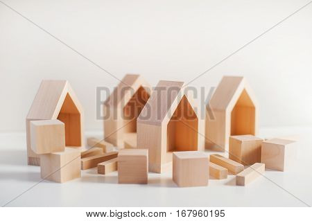 wooden construction made of small houses cubes and bricks
