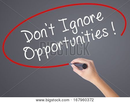 Woman Hand Writing Don't Ignore Opportunities Black Marker On Visual Screen