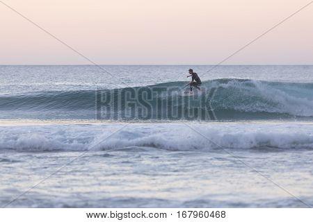 EL Cotillo, Spain - Dec 22, 2015: Surfer riding a wave at El Cotillo beach, famous surfing destination on Fuerteventura, Canary Islands, Spain on December 22, 2015.