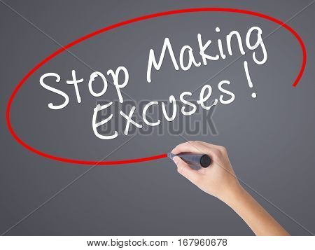 Woman Hand Writing Stop Making Excuses With Black Marker On Visual Screen