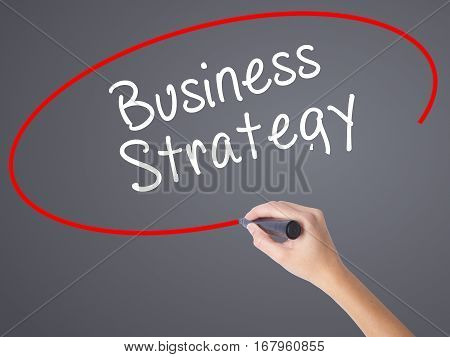 Woman Hand Writing Business Strategy With Black Marker On Visual Screen