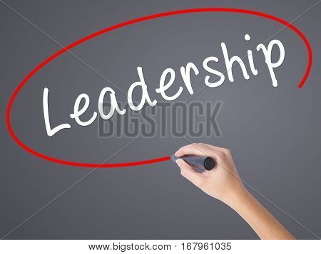 Woman Hand Writing Leadership With Black Marker On Visual Screen