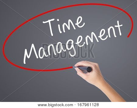 Woman Hand Writing Time Management With Black Marker On Visual Screen
