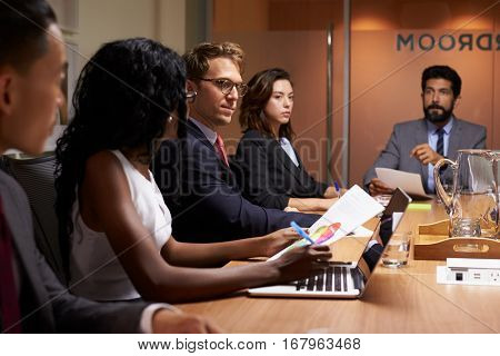 Business people at an evening boardroom meeting, close up
