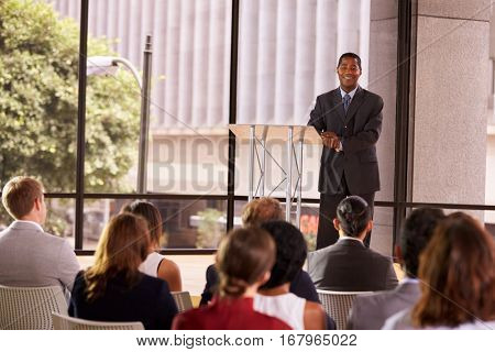 Black businessman presenting seminar smiling to audience