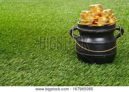 closeup pot of gold on grass with handle
