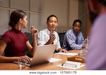 Business colleagues in discussion at a meeting, close up