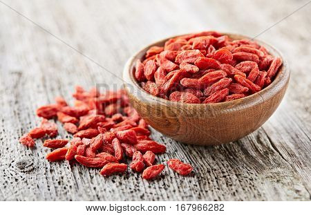 Goji berries on a wooden board