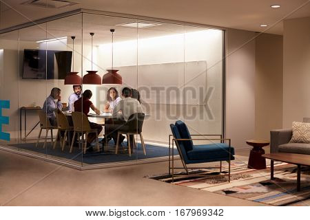 Team in a meeting cubicle at a big corporate business