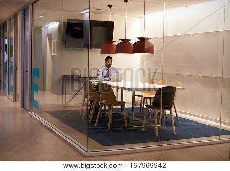 Black businessman working in cubicle at a corporate business