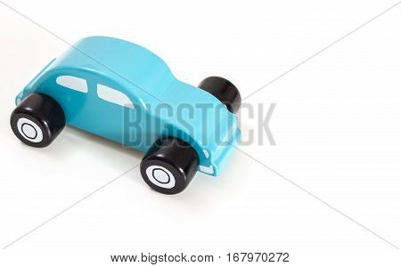 A blue toy car on white background with copy-space.