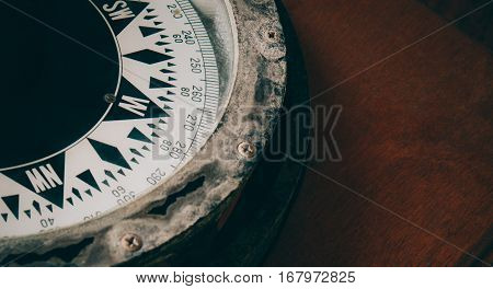 Close-up Of Ancient Boat Compass Aboard On Old Vintage Wood. Vintage Ship Compass.