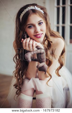 Fashion photo of young beautiful girl wearing wedding dress. Happy smiling bride. Professional make-up and hairstyle. Perfect skin. Fashion photo. Lolita style. Natural beauty.